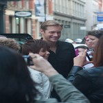 alexander skarsgard surrounded by fans outside the Apple Soho store in NY