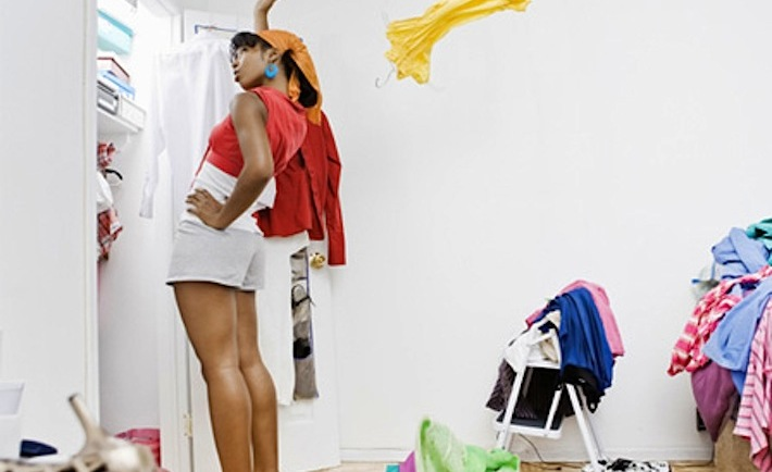 woman-spring-cleaning-her-closet